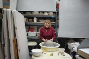 Ceramic artist Susan Card behind her potter's wheel